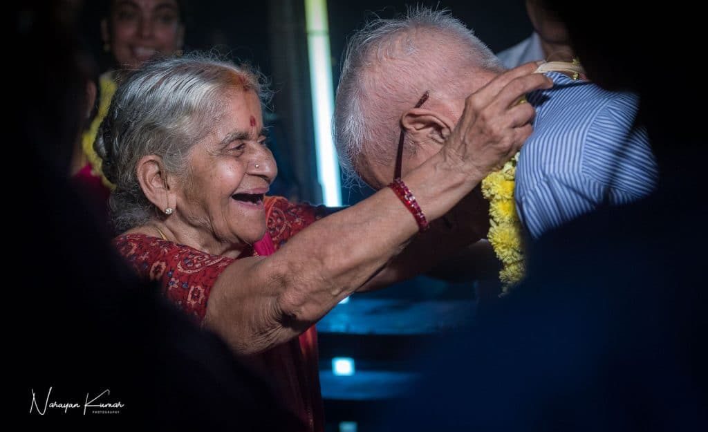 Old couple exchanging garlands