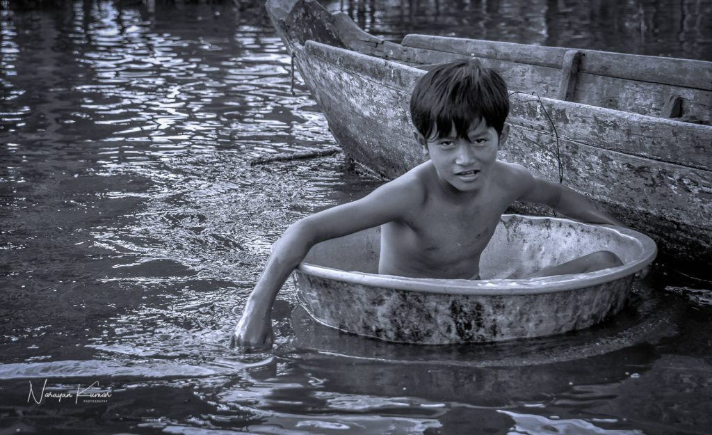 boy in water cambodia